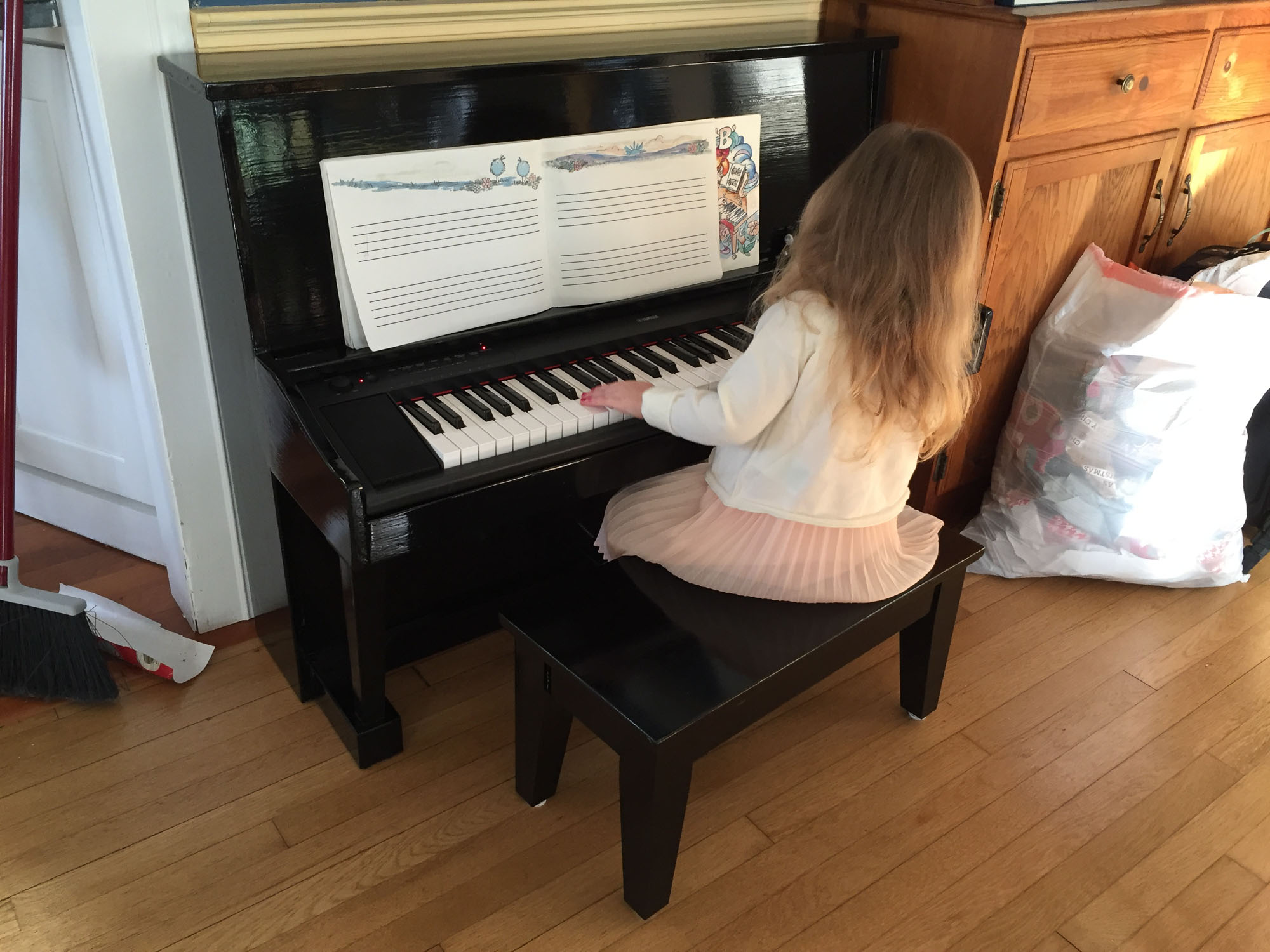 Avery playing the piano